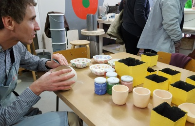 One of the artists with examples of pottery produced using the Gentle Art Living Art methodology