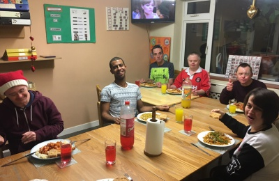 Diagrama Foundation: The residents of Cabrini House enjoying their Chinese takeaway.