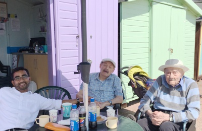 Edensor Care Centre team leader Muhammed Neeliyath with residents enjoying the beach hut day out